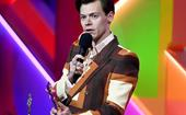 Harry Styles Collected His Brit Awards Trophy Whilst Wearing A Trophy Bag