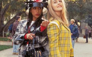 Alivia Silverstone wearing a yellow plaid suit in Clueless
