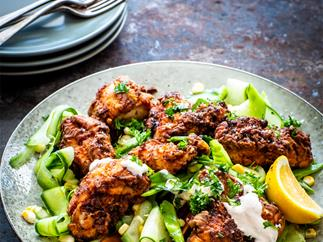 Crispy fried chicken with cucumber and corn salad