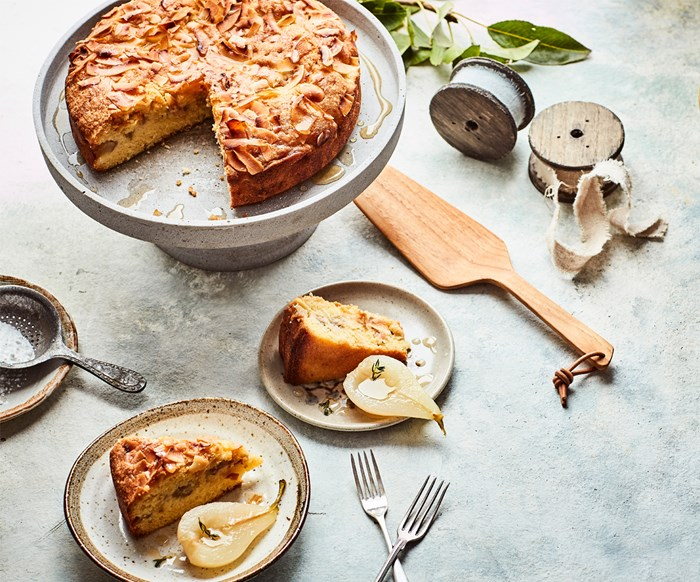 Pear and toasted coconut cake with honey and thyme poached pears