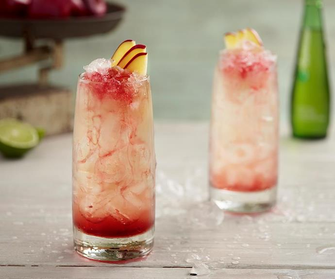 glass of non-alcoholic mocktail with apple slices