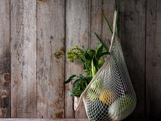 reusable cotton produce bag hanging on wall