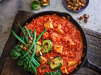 Tempeh and red lentil curry with roasted greens
