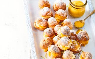 Profiteroles with homemade mango curd