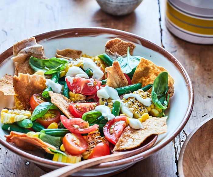 grilled corn salad in bowl on table