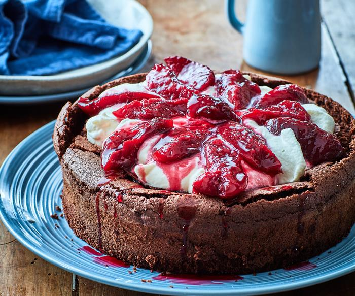 chocolate plum cake with cream on blue plate