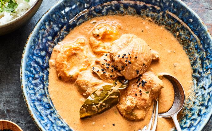 Chicken and apricot curry in blue bowl