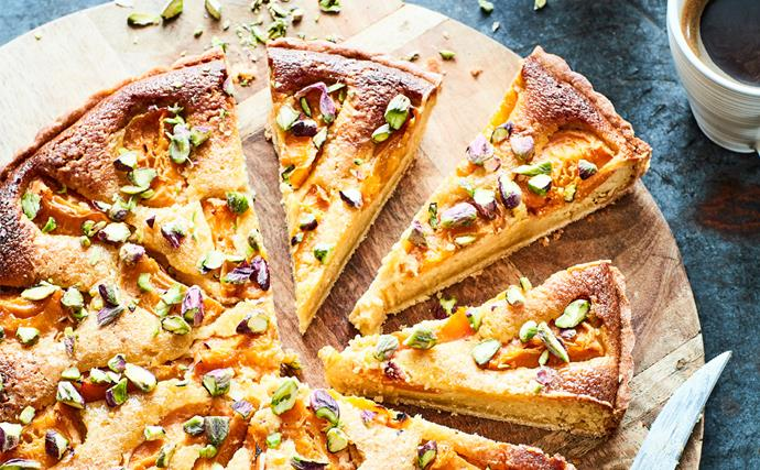 Apricot and pistachio tart on wooden board