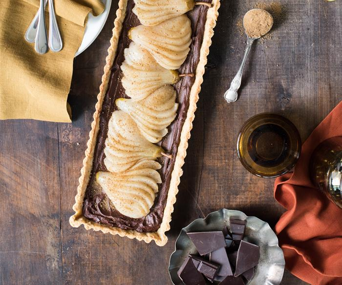 pear and chocolate tart on wooden table