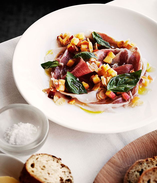 **Shaved prosciutto with peach and almond salsa**