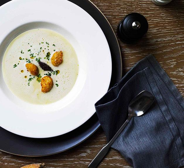 White onion velouté with crisp garlic and tapenade