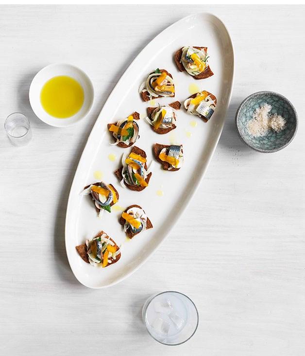 Cured sardine, fennel, mushroom and bottarga salad on croûtons