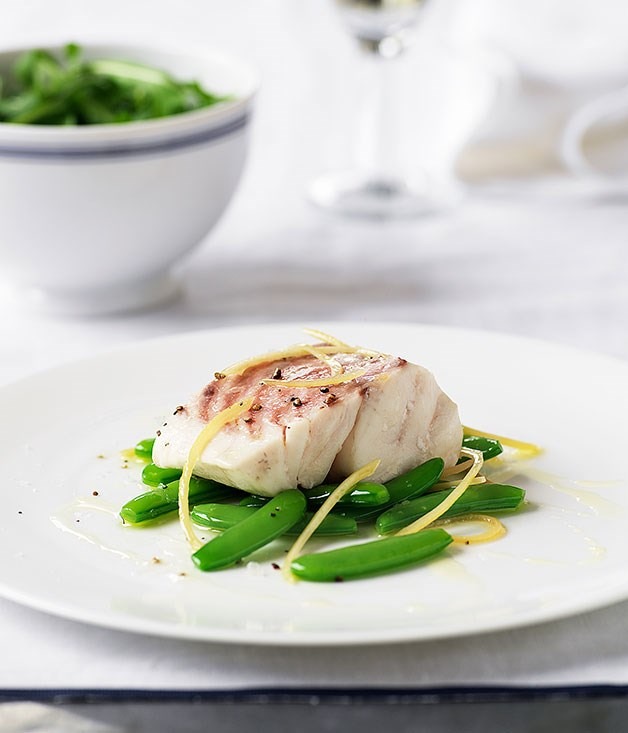 Steamed bass grouper with sugar snap peas and lemon