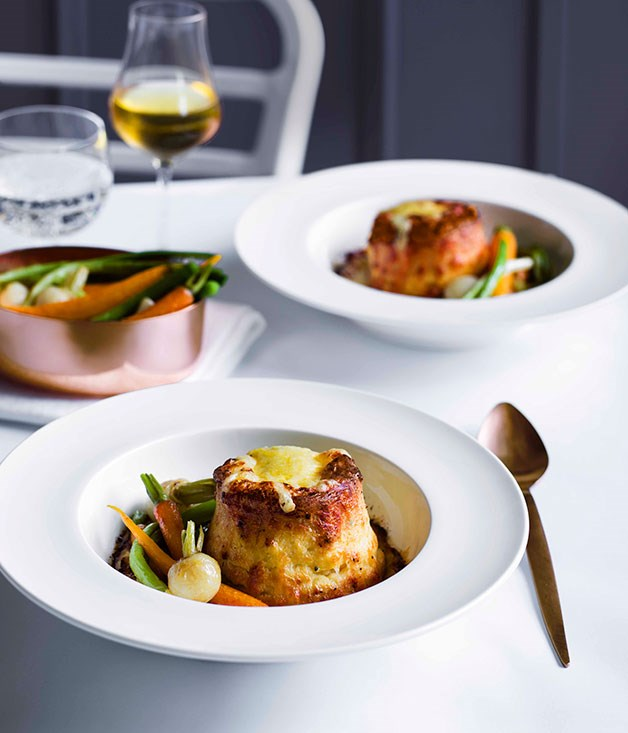 Twice-baked Gruyère soufflés with baby vegetables