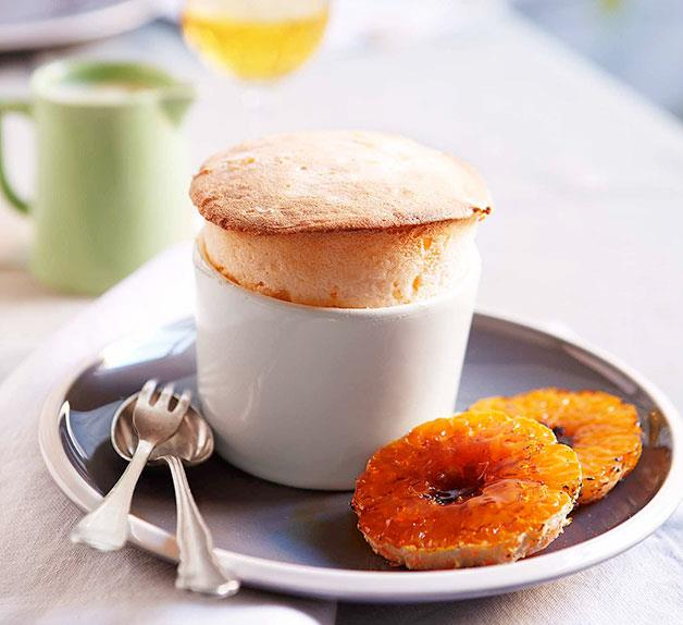 Mandarin soufflé with white chocolate sauce