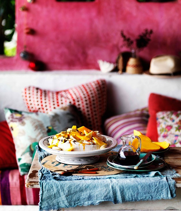 Golden pavlova with mango yoghurt and tropical fruits