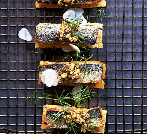 Sardines on toast with sweet onion and pine nut tarator