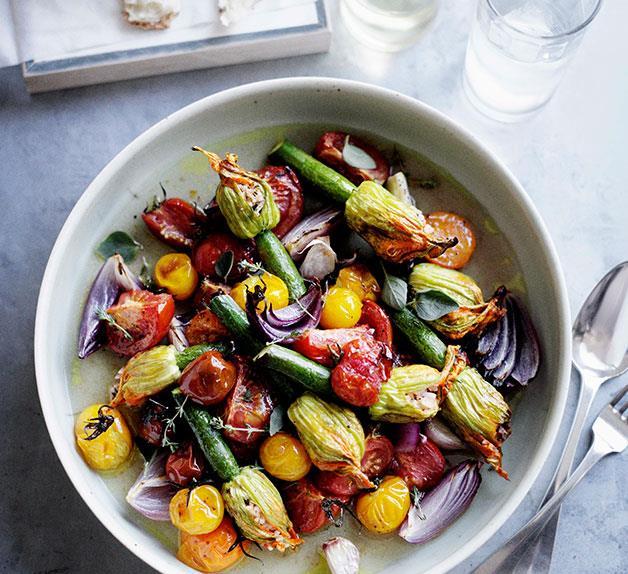 Roast stuffed zucchini flowers with tomato and oregano