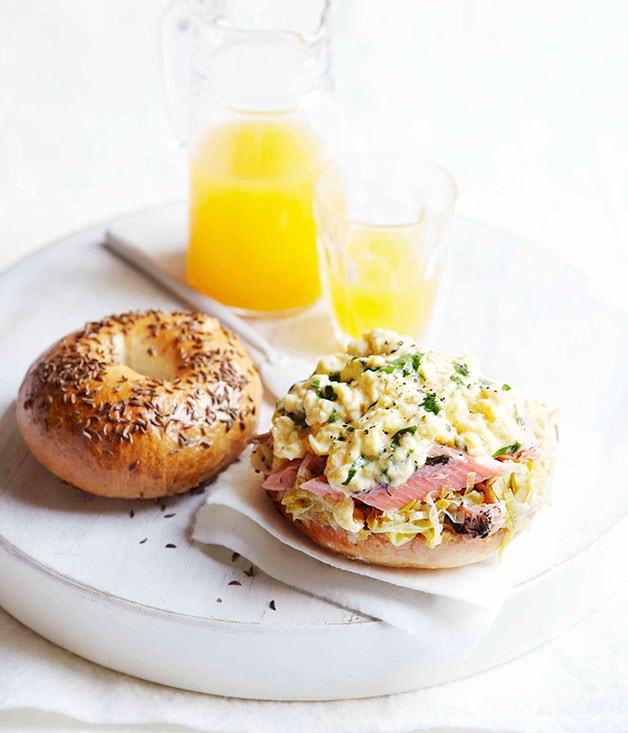Caraway seed bagels with hot-smoked trout, buttered leeks and scrambled eggs