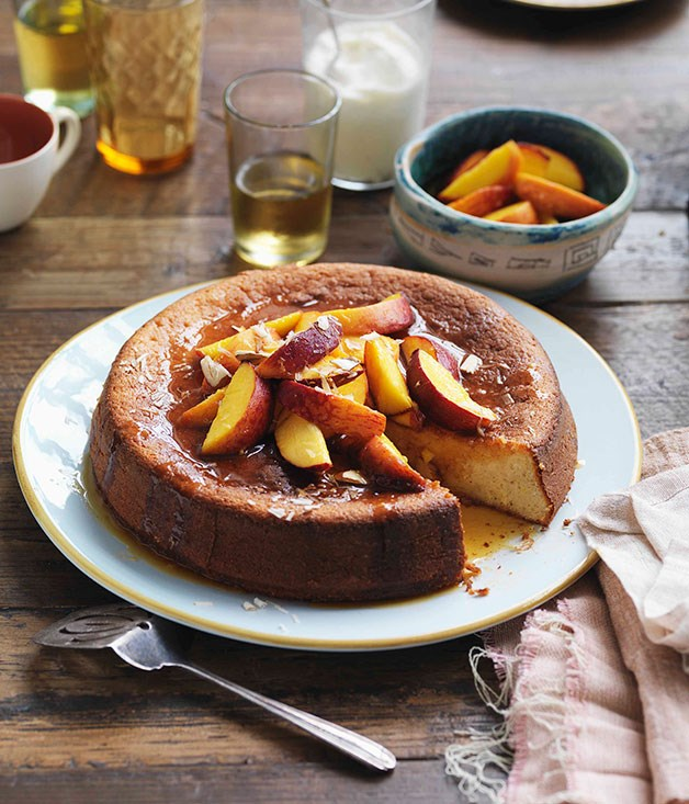 Yoghurt and almond cake with orange-caramel peaches and vanilla yoghurt