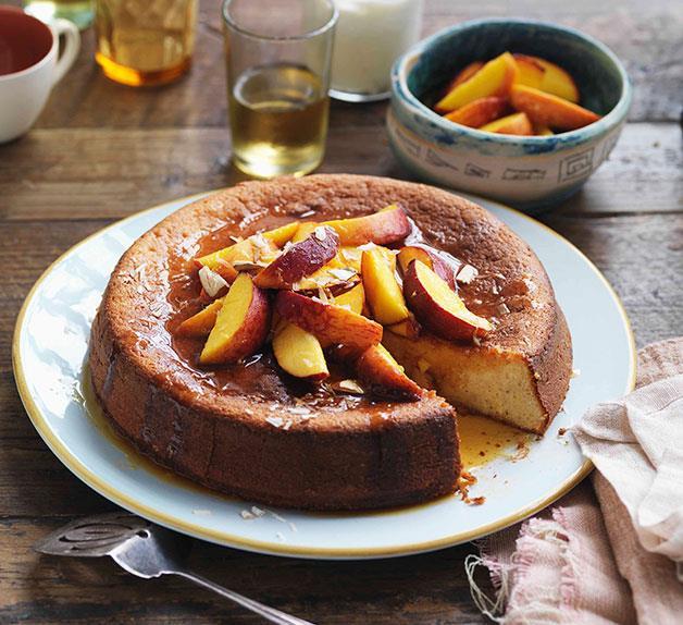 Yoghurt and almond cake with orange-caramel peaches and vanilla yoghurt