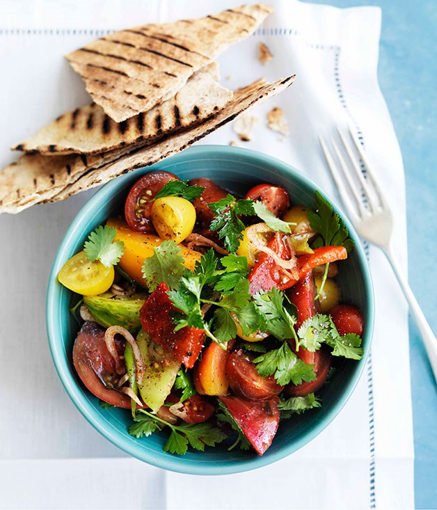 Mixed tomato salad with sumac, herbs and flatbread