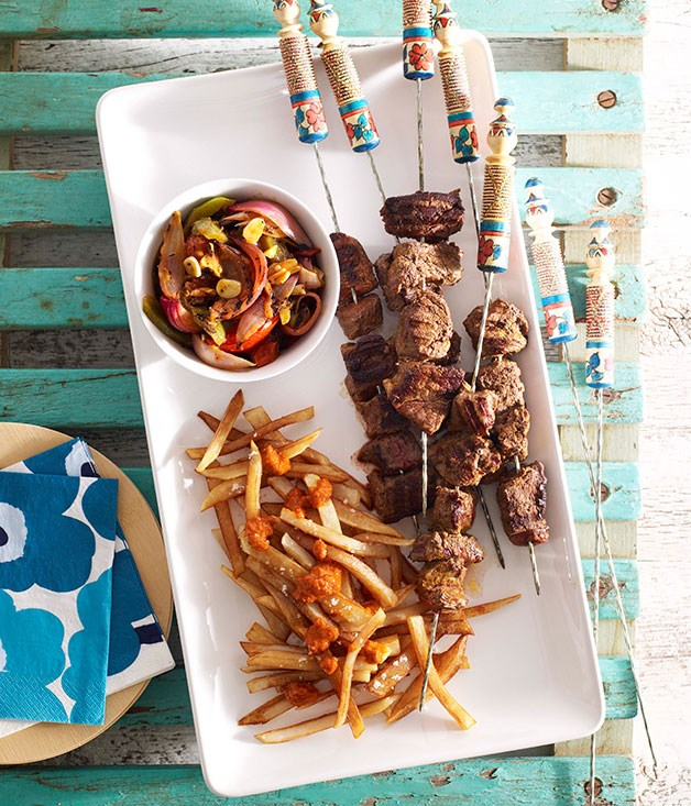 Moroccan beef kebabs with harissa chips and grilled vegetable salad