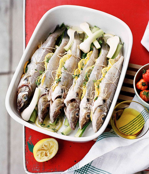 Whole whiting roasted with tomato, lemon and young garlic