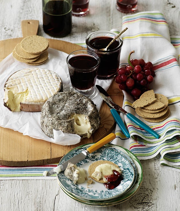 Cheese board with grape jelly and oat biscuits