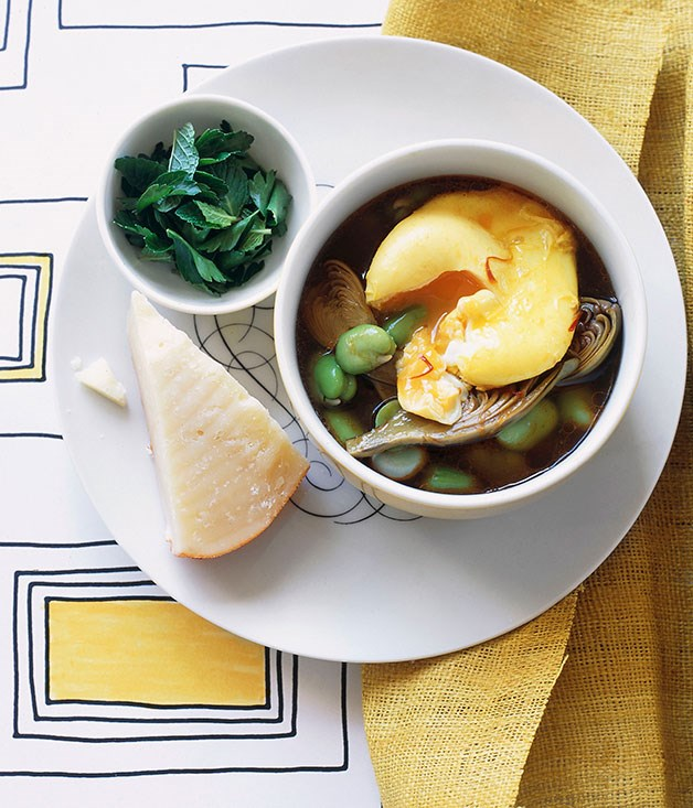 Broad bean and artichoke hotpot with saffron eggs