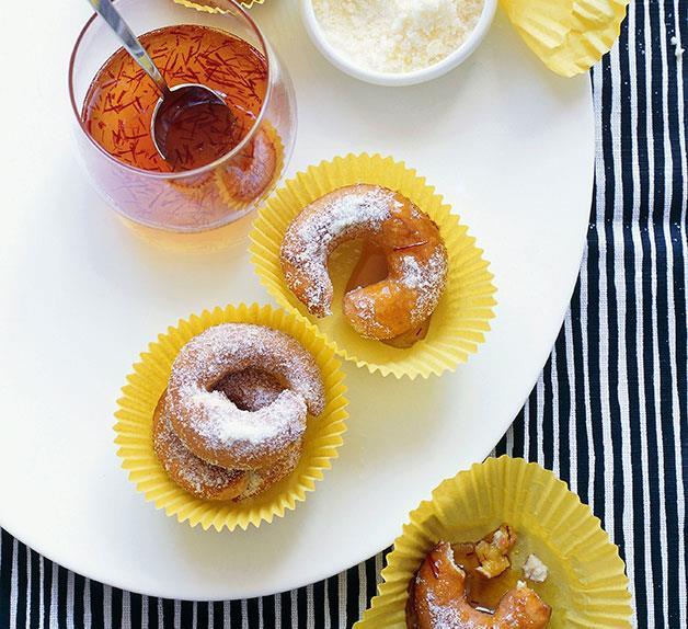 Orange buñuelos with saffron honey