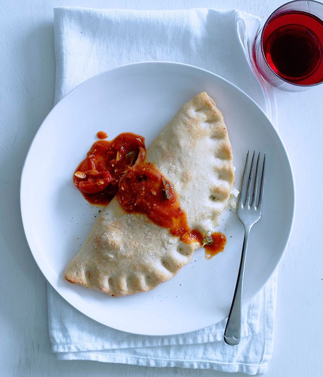 Three-cheese calzone with tomato-chilli sugo