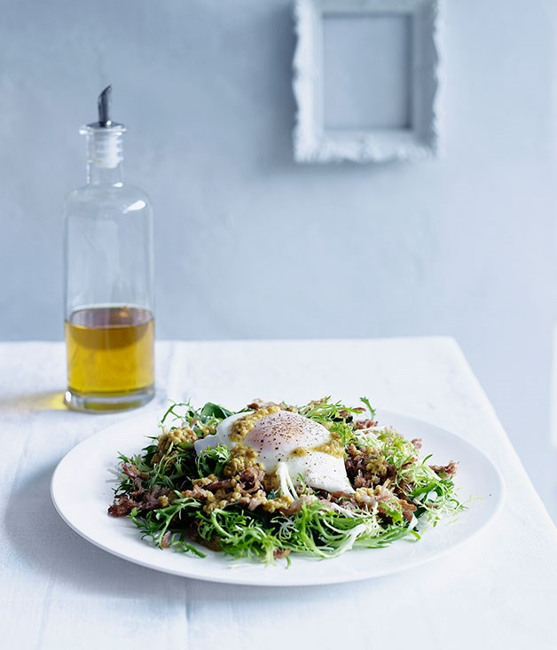 Rillettes, bitter greens and poached egg salad with garlic vinaigrette