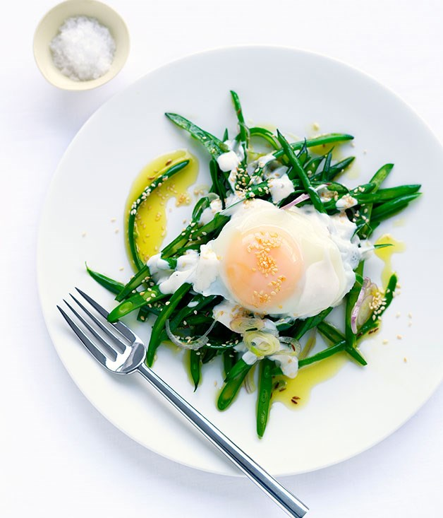 Braised beans with tahini yoghurt and poached egg