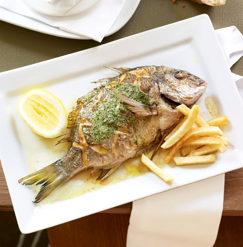 **Whole sea bream with herb butter**