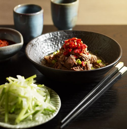 **Shredded lamb shoulder with salted chilli & Chinese celery and onion pickle**