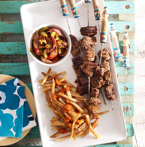 **Moroccan beef kebabs with harissa chips and grilled vegetable salad**