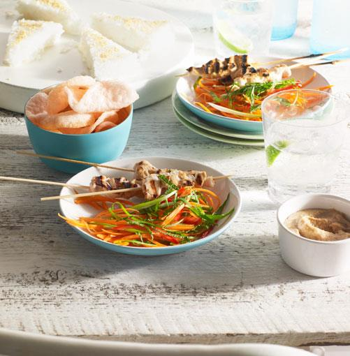 **Chicken satay with pressed rice, peanut sauce and carrot salad**