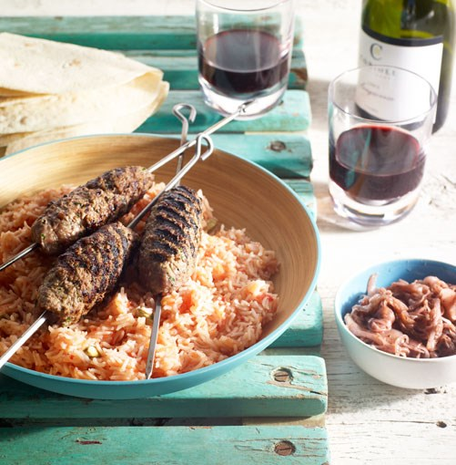 **Lamb kofta with tomato rice and sumac fried onions**