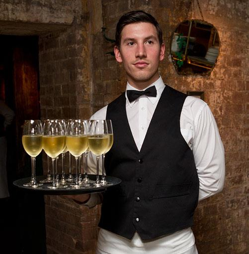 **** Waiters armed with glasses of Laurent Perrier.