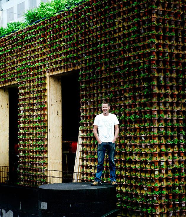 **** **Power plants**   Joost Bakker outside one of his signature vertical gardens at the temporary Greenhouse in Melbourne.      PHOTOGRAPHY JULIAN KINGMA