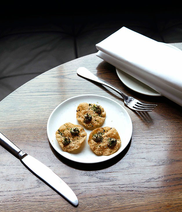 **** **Taste sensation**   Seaweed crackers with burnt eggplant and furikake at Cutler & Co., Melbourne.      PHOTOGRAPHY JULIAN KINGMA