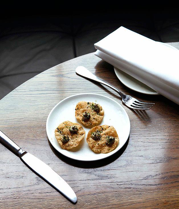 **** **Taste sensation**   Seaweed crackers with burnt eggplant and furikake at Cutler & Co., Melbourne.      PHOTOGRAPHY JULIAN KINGMA