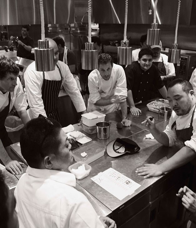 """**** """"Everybody who's not a f\*\*\*ing chef get out of the f\*\*\*ing kitchen right now"""": David Chang talks his fellow Raw chefs (including, clockwise from bottom left, Yoshihiro Narisawa, Daniel Patterson, Mark Best, Matthew """"Rudy"""" Rudofker, Mauro Colagreco, Sean Brock, Magnus Nilsson and Ben Shewry) through the dinner game-plan."""
