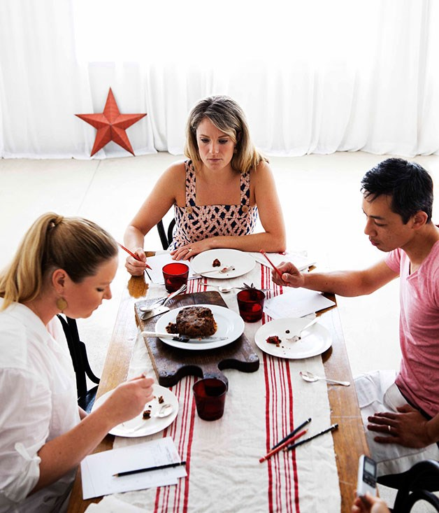 **** Have your cake and…   Clockwise from far left: Lisa Featherby (left), Jane Strode and Christopher Thé contemplate the Puddings on the Ritz Christmas cake; Coles iced Christmas cake; tasting notes; Phillippa's Christmas cake; Newcastle's Pudding Lady cake.