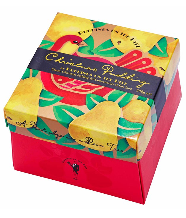 **** PUDDINGS ON THE RITZ CHRISTMAS CAKE 500gm, $27.95   It's very dry – it even looks dry. It doesn't cut nicely either, it just falls apart. JS 2   I like the dried figs, but the glacé cherries are too strong. CT 2   I like the colour of this one. It's full of fruit and I can see some cherries, which is nice. It's really dry. It's like the sultanas haven't been plumped properly. LF 2
