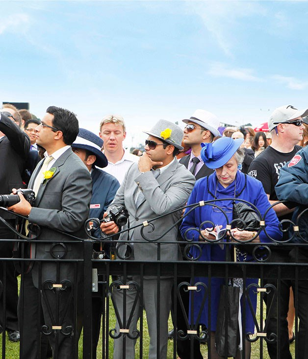 **** Well dressed punters watching the race.