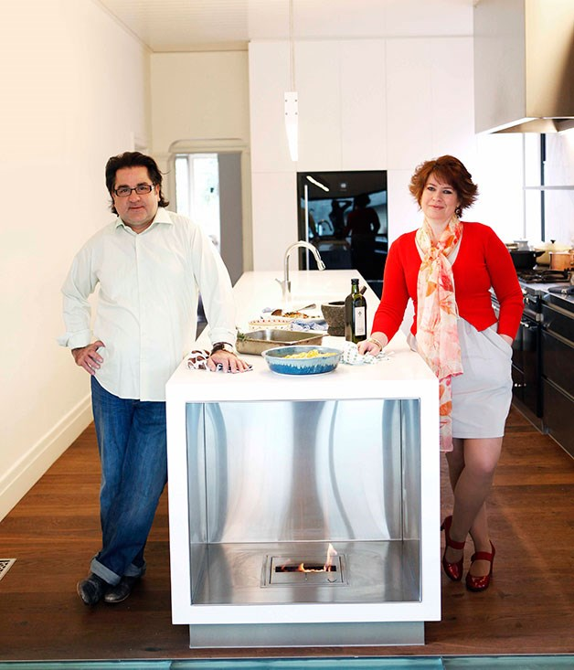 **Guy Grossi's home kitchen** **Star centrepiece**   Guy and Melissa Grossi and the 5.5-metre Corian island bench complete with Ecosmart fireplace and Lacanche cooker at the hub of their new kitchen.
