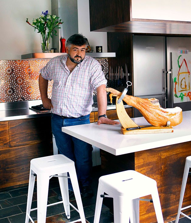 **Frank Camorra's kitchen** **Spanish acquisitions**   Frank Camorra's home kitchen hints at the style of his MoVida restaurants with its glittering splashback and designer stools.