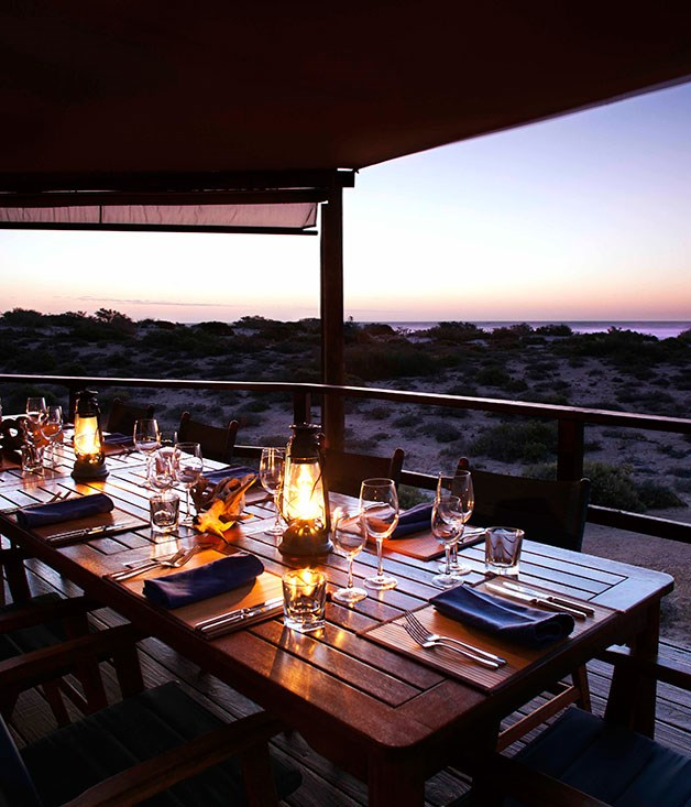 **Sal Salis Ningaloo Reef, WA** Best Sustainable Tourism Venture: Sal Salis Ningaloo Reef, WA   Runner-up: The Maria Island Walk, Tas   Wild Bush Luxury pioneered sustainable, African-style safari tourism in Australia but the concept finds its environmentally purest expression on WA's North West Cape. Sal Salis comprises just nine comfortable tents – set among the dunes about 50 metres from the Indian Ocean shoreline – where the power is solar, the water supply is carefully monitored and filtered on-site and the human impact is offset by clever cleansing technologies. But being kind to the environment of the Cape Range National Park does not mean skimping on creatures or comforts; high thread-count bedding, ensuite bathrooms, and sunset dinners with an audience of kangaroos and wallabies are all part of the experience. And, right on the camp's doorstep, one of Australia's great reef ecosystems teems with hundreds of fish and coral species, turtles, humpback whales and manta rays. www.salsalis.com.au